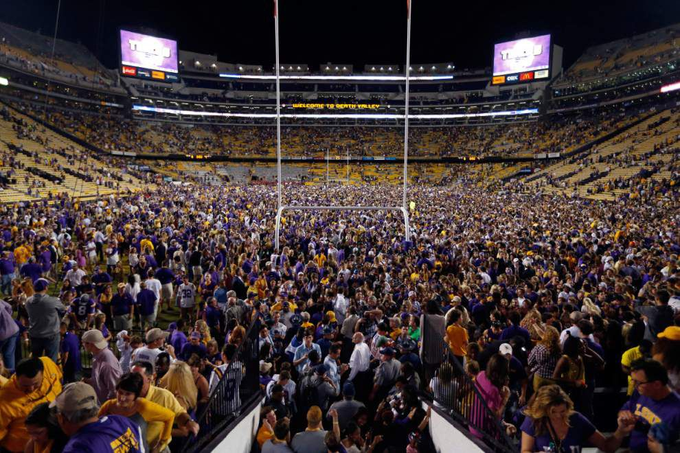 Video: LSU fans storm the field at Tiger Stadium in jubilation after the No. 24 Tigers upset No. 3 Ole Miss _lowres