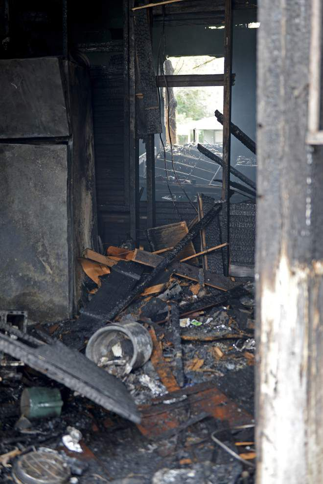 Space heater starts house fire; residents unhurt but family's dog dies _lowres