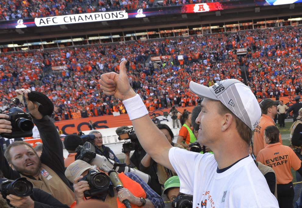 Manning passes physical with Broncos, set for 2014 return _lowres