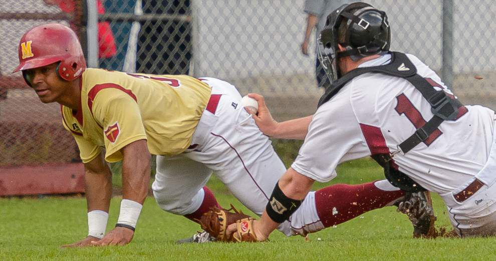 Behind Logan Babin's arm, Destrehan tops Brother Martin _lowres