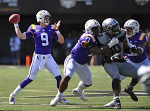 LSU's offense rolls in a 66-38 win over Vanderbilt; Joe Burrow sets school touchdown record