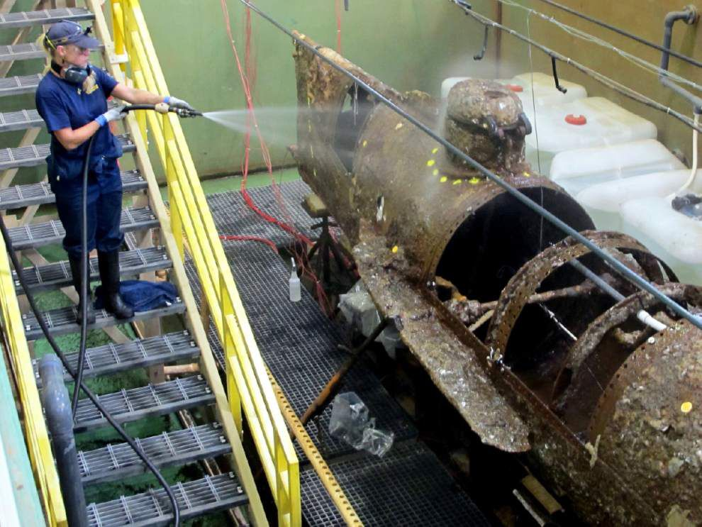 Scientists remove encrustation on Confederate sub _lowres