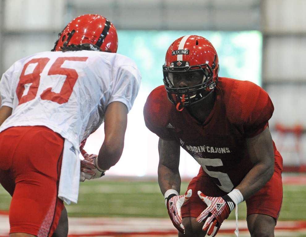 JUCO teammates C.J. Bates and Antoinne Adkins now face each other in practice _lowres