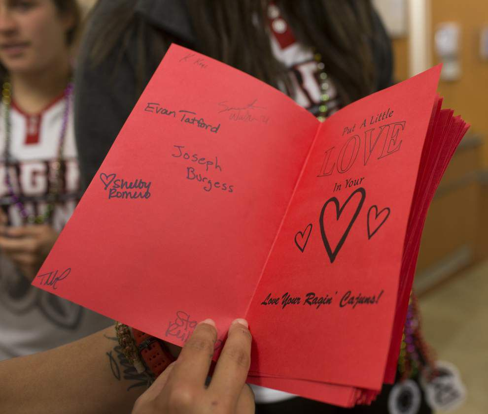 Photos: Lady Cajuns deliver Valentine at Lourdes _lowres