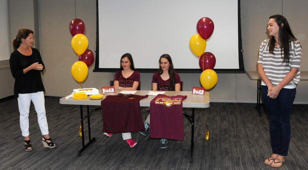 Sisters sign scholarships to cheer at Pearl River _lowres