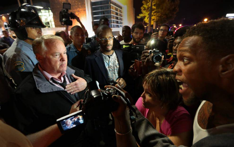 Police, protesters scuffle in Ferguson, Mo., after police chief's apology _lowres