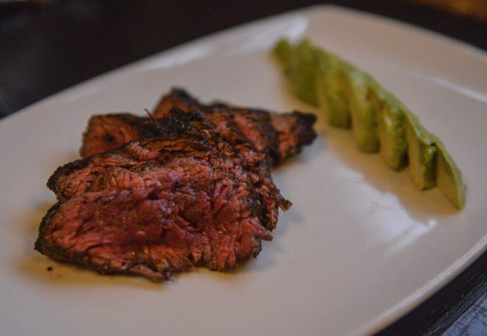 Well-settled in its new home, a unique steakhouse makes a case for unconventional cuts, wines to match _lowres