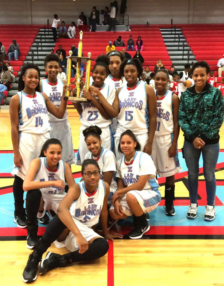 JV Lady Broncos win basketball tournament _lowres
