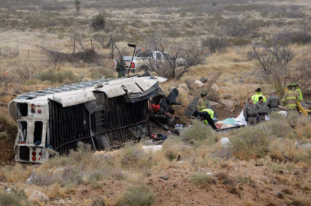 At least 10 killed when prison bus strikes train in Texas _lowres