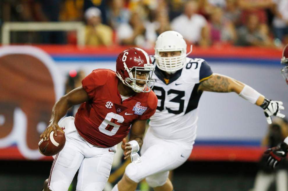 Alabama outlasts stubborn West Virginia 33-23 _lowres