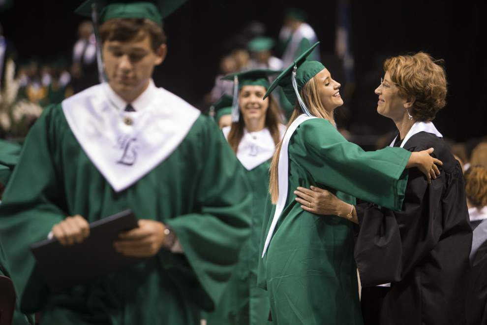 Seniors from five Lafayette Parish high schools received diplomas Saturday during ceremonies at the Cajundome _lowres