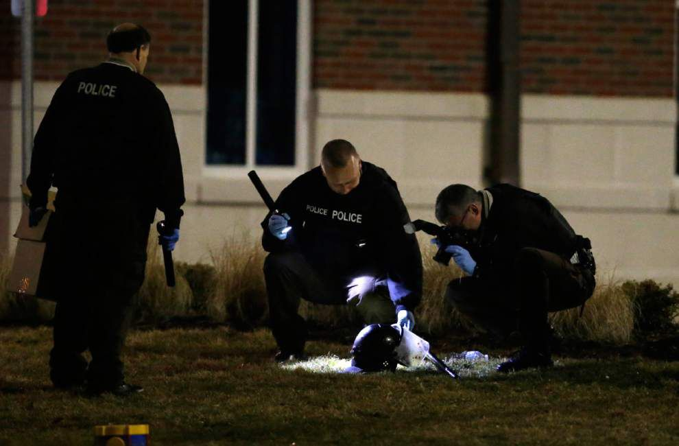 2 officers shot at protest outside Ferguson police station _lowres