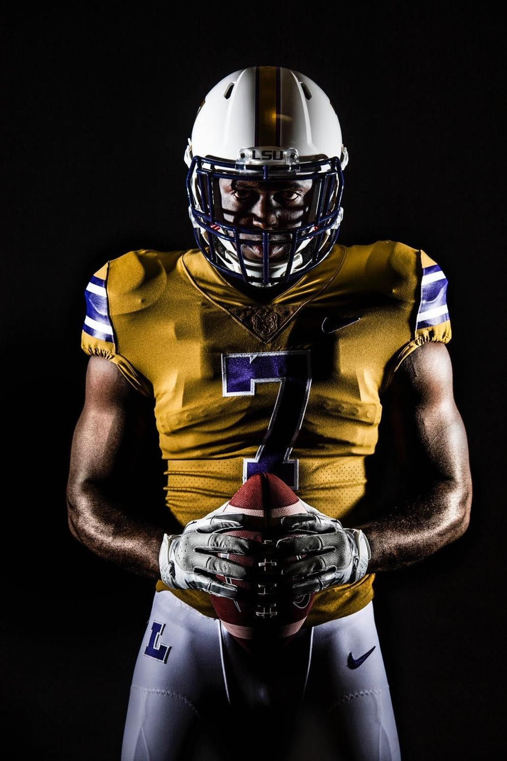 LSU wearing gold jerseys, white helmets with numerals for ...