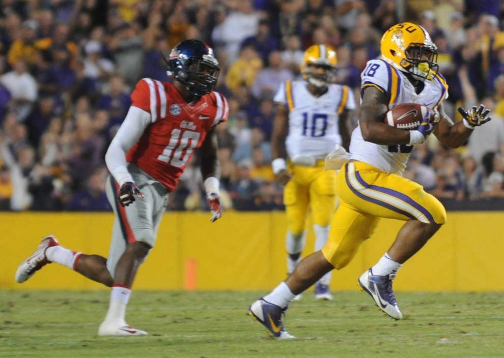 LSU coach Les Miles says running back Terrence Magee is fine after getting 'gouged' in the eye _lowres