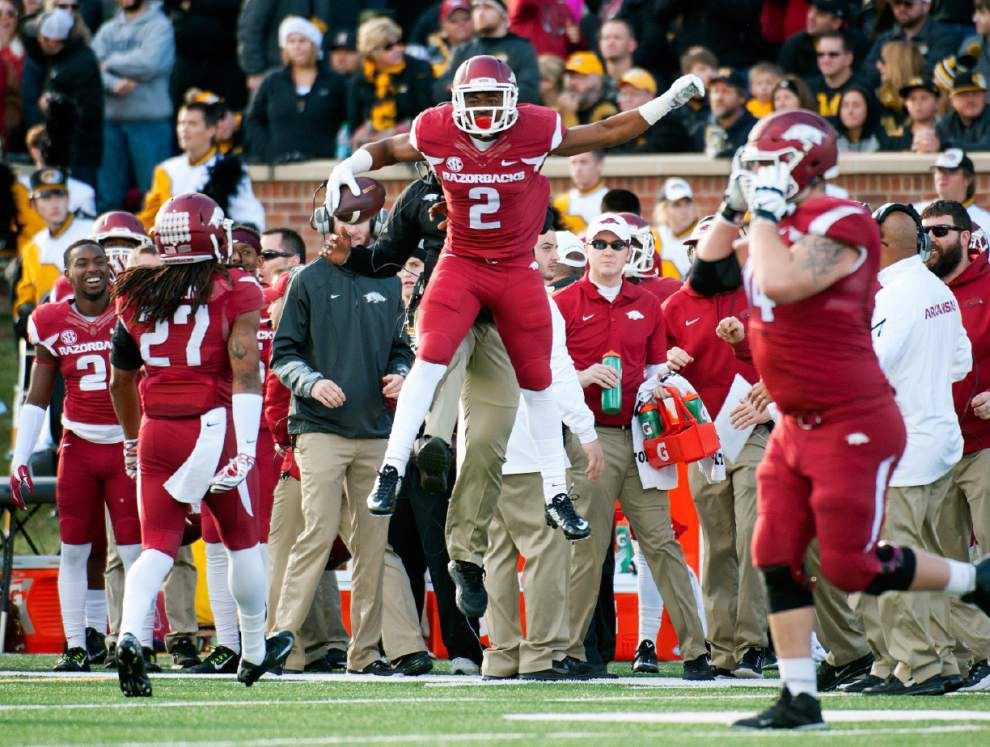 Missouri rallies past Arkansas 21-14, returns to title game _lowres