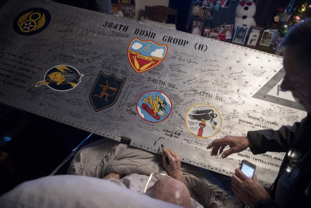 Baton Rouge veteran, now 90, shares WW II ordeal as he signs B-17 wing panel _lowres