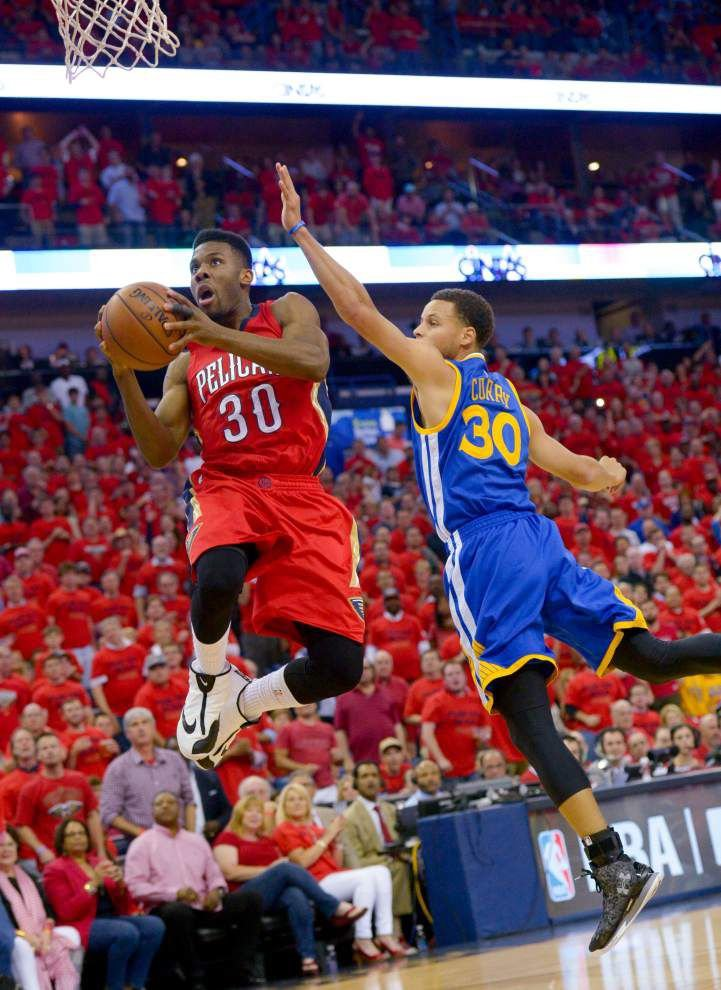 Pelicans can't hold lead, fall to Warriors in OT _lowres