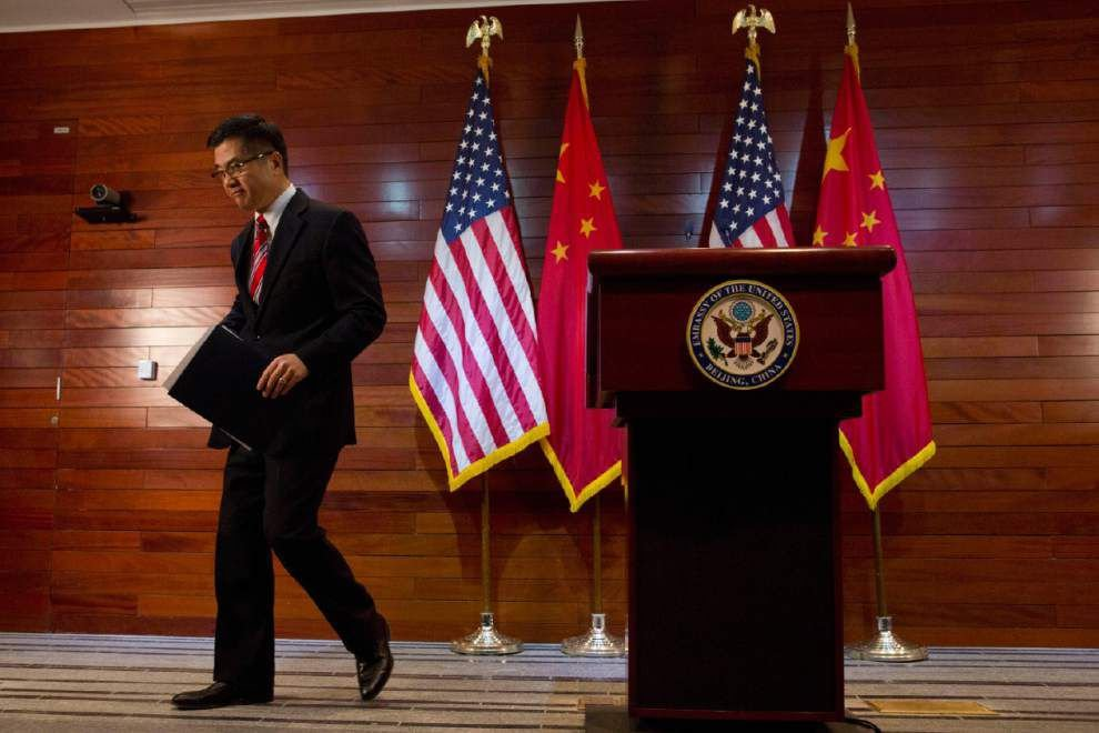Chinese media outlet uses racial slur at U.S. envoy _lowres