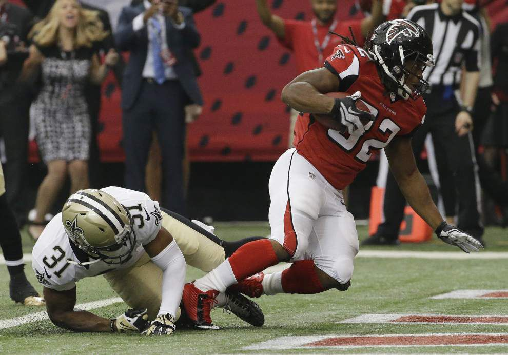 Saints defense crumbles as Falcons rally for 37-34 win in overtime _lowres