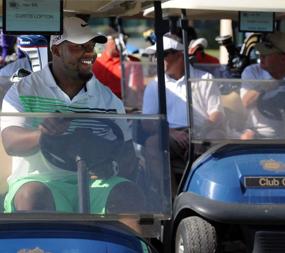 Saints tee off to benefit museum _lowres