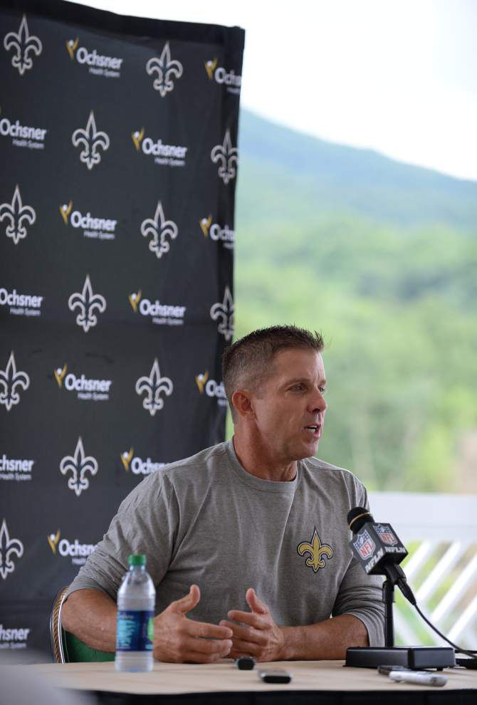 Saints coach Payton tackles team physical himself _lowres