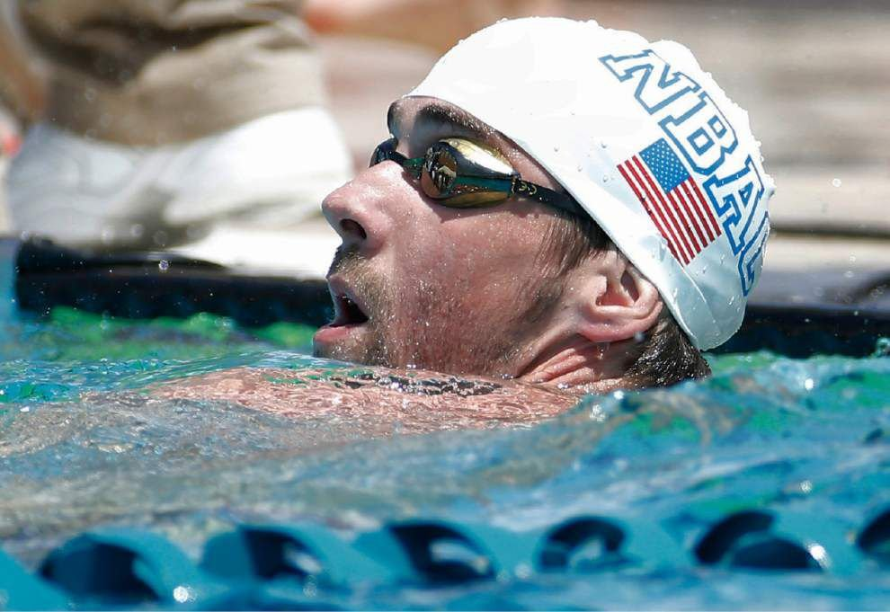 Michael Phelps wins 100 fly heat in comeback meet _lowres