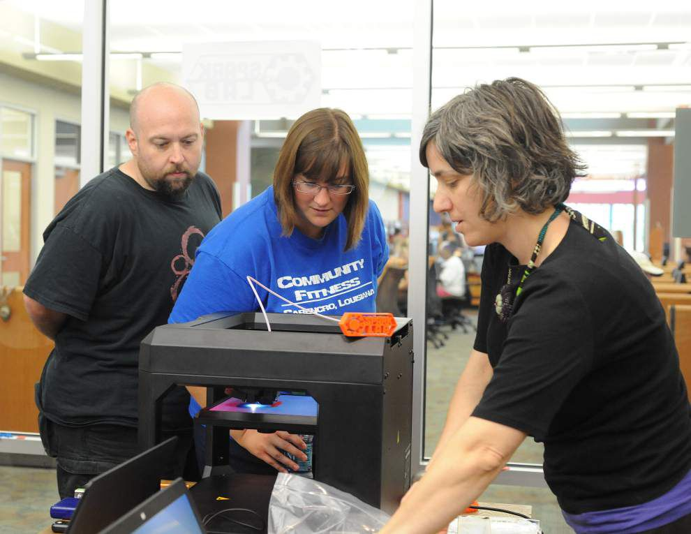 Patrons learning to use 3D printer at South Regional Library _lowres