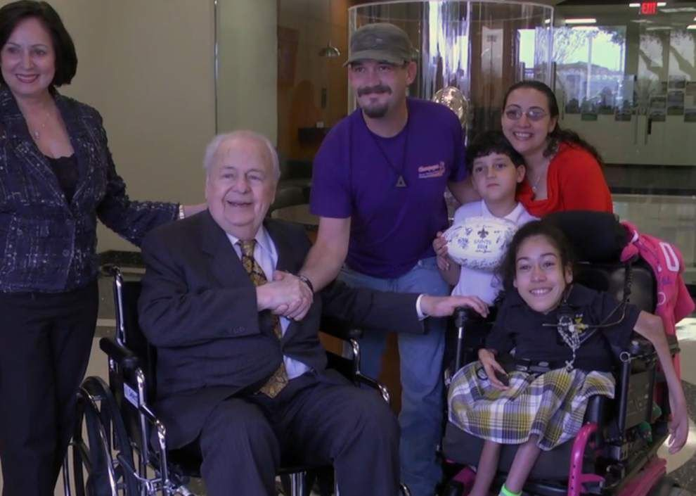 See how New Orleans Saints owners Tom and Gayle Benson's special gift brought smiles of gratitude and relief for one family _lowres