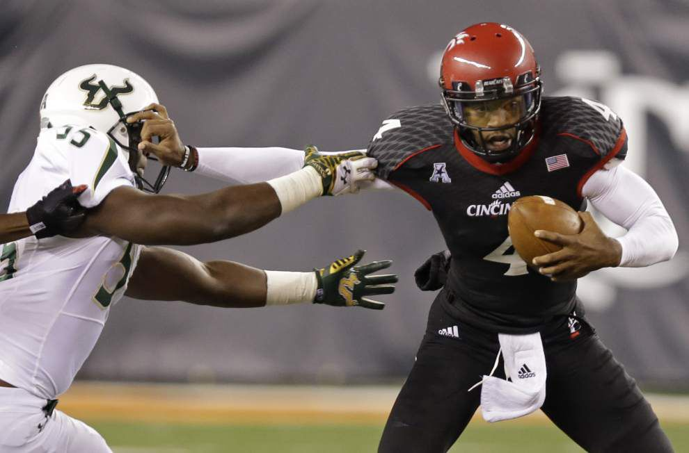Cincinnati quarterback Munchie Megaux, a Karr High graduate, aims for sweet homecoming _lowres