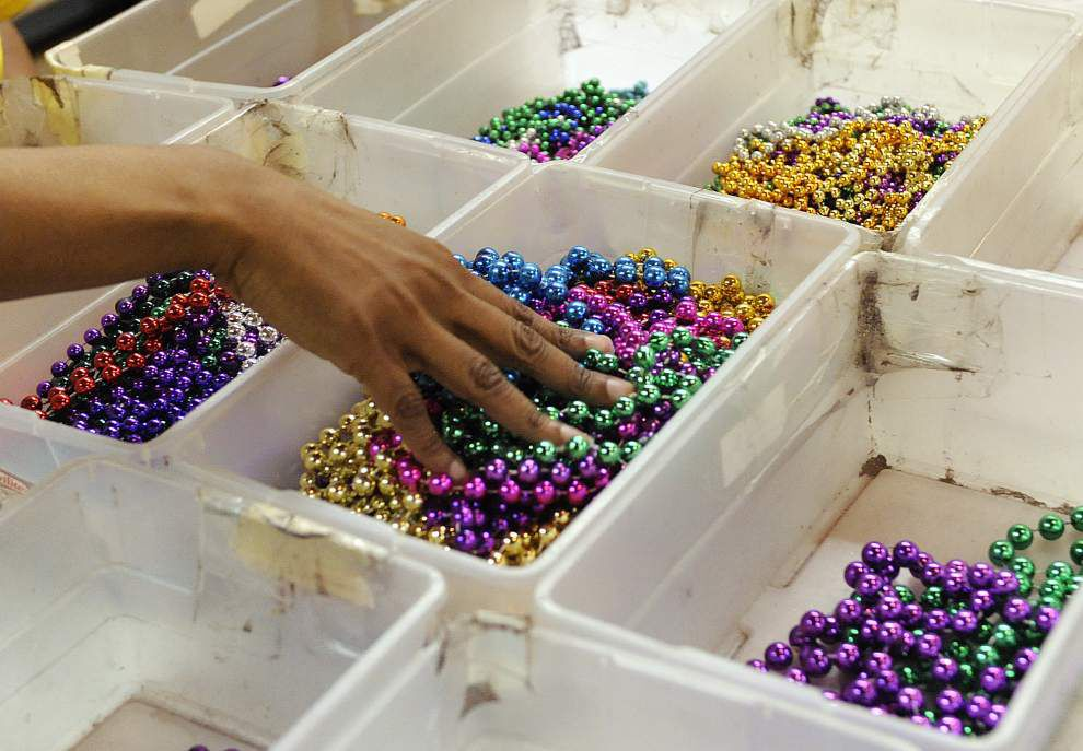 Nonprofit groups recycle Mardi Gras beads and help developmentally disabled adults _lowres