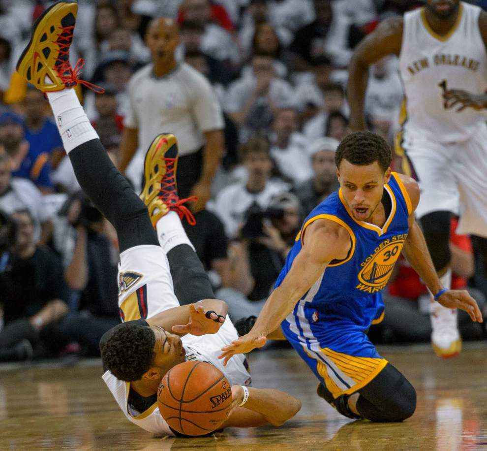 Photos: Golden State surge sinks Pelicans in OT _lowres