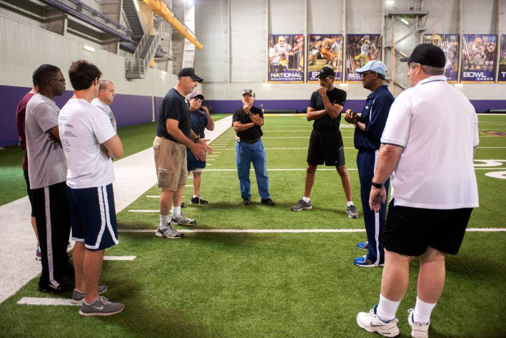 Local fans step up to be newest crop of football officials _lowres