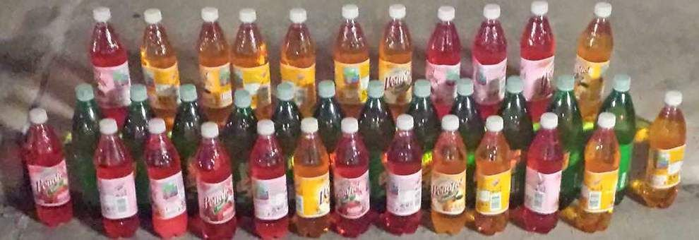 Police seize 36 soda bottles filled with liquid meth from commercial bus _lowres