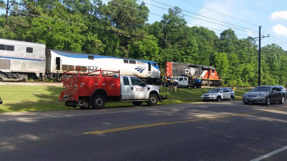 Amite fire chief: Amtrak train slams into tow truck killing driver, injuring two passengers _lowres