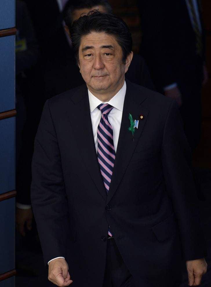 Japan prime minister sends offering to war shrine _lowres