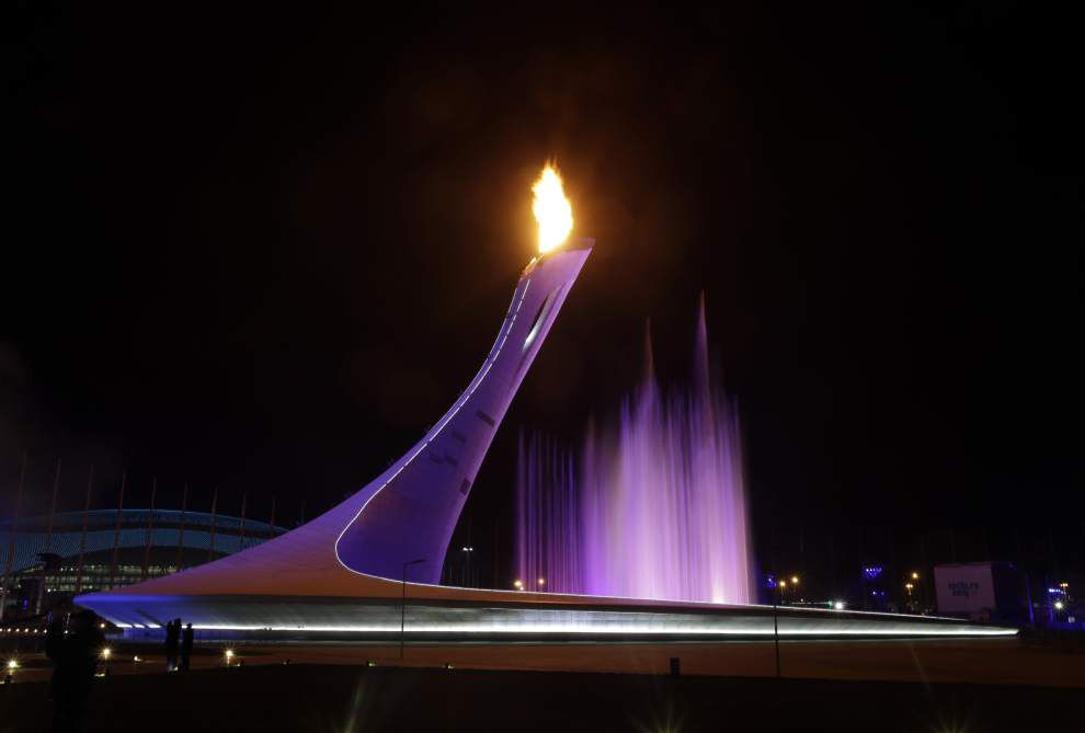 Olympic greats Tretiak, Rodnina light cauldron _lowres