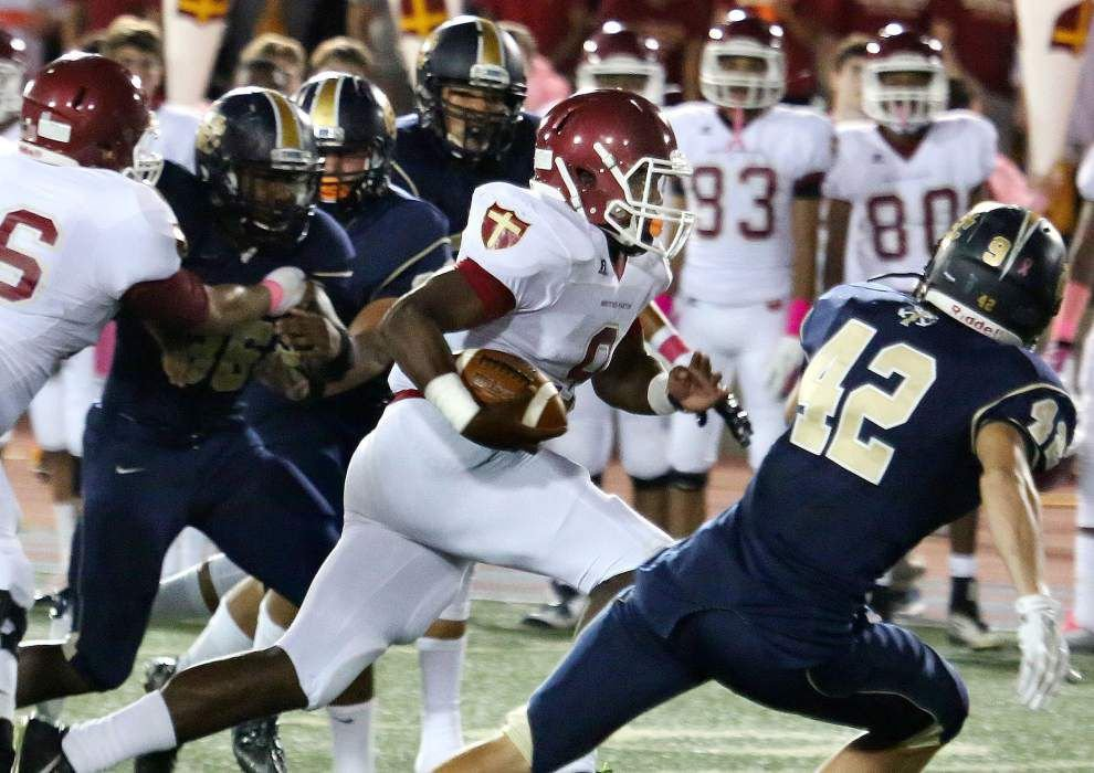 Brother Martin runs past Holy Cross _lowres