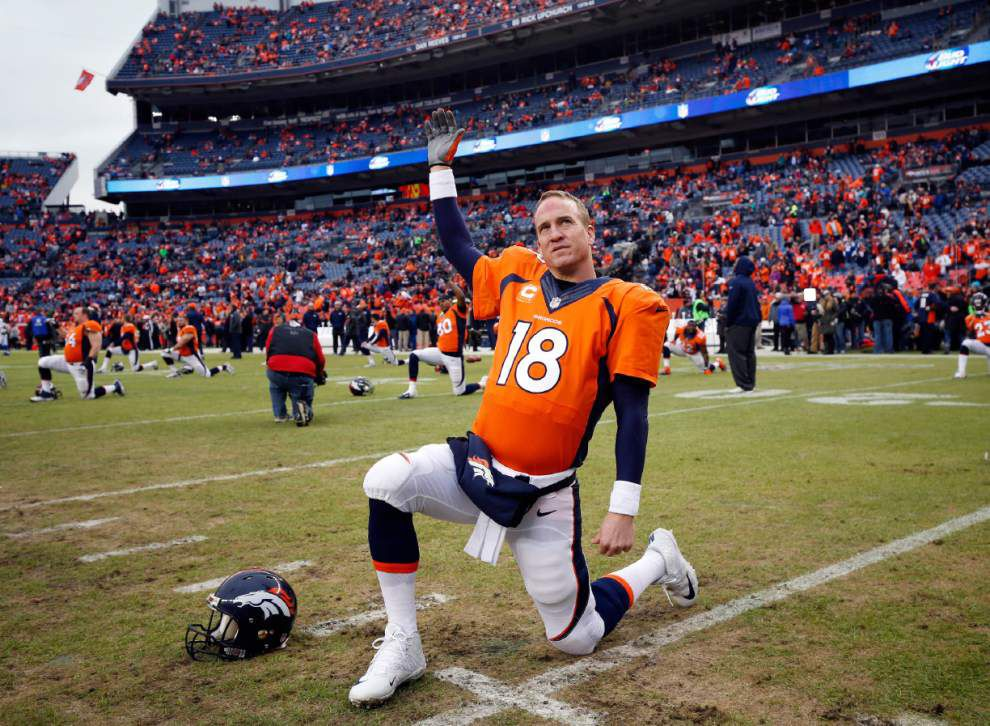 Report: Peyton Manning takes pay cut to return to Broncos _lowres