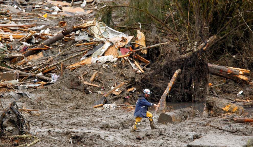 Search for mudslide missing comes down to shovels _lowres