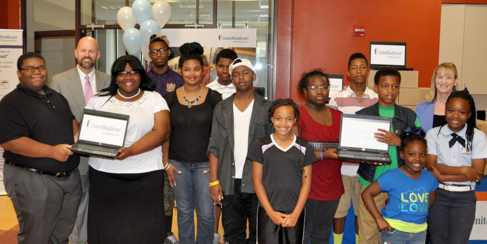 Refurbished laptop computers donated to four New Orleans groups _lowres