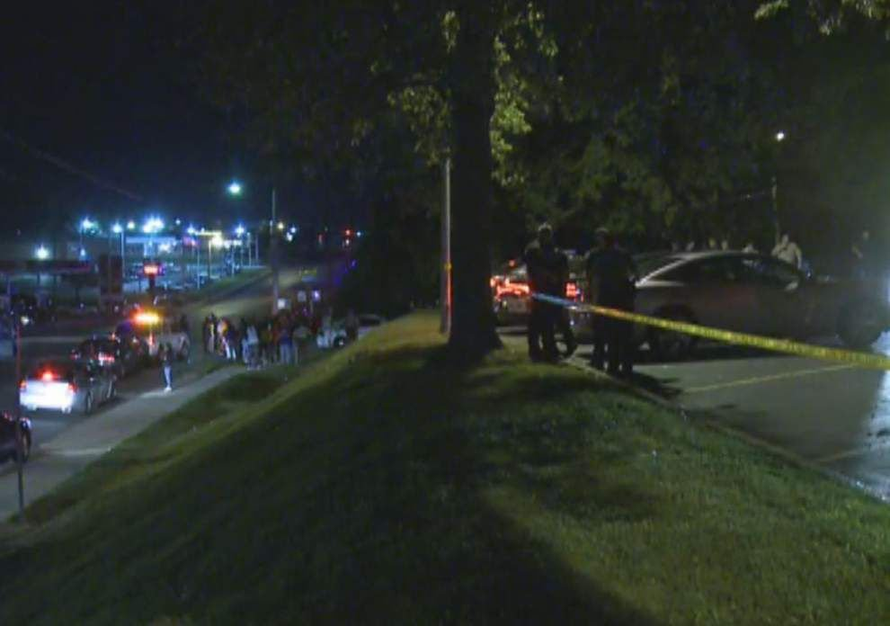 Ferguson, Mo., officer shot in arm; 2 suspects wanted _lowres