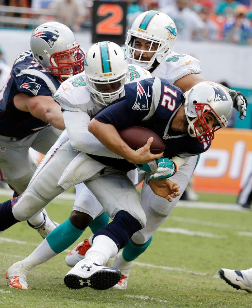 Miami dominates second half, tops New England 33-20 _lowres