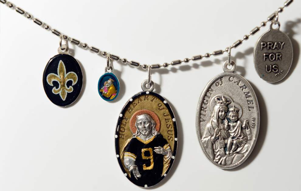 Saints medals give the faithful something to hang onto _lowres