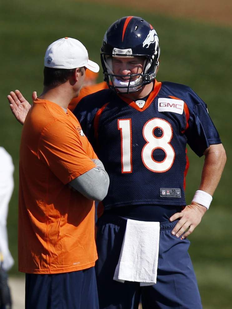 New faces aplenty surrounding Broncos QB Peyton Manning _lowres
