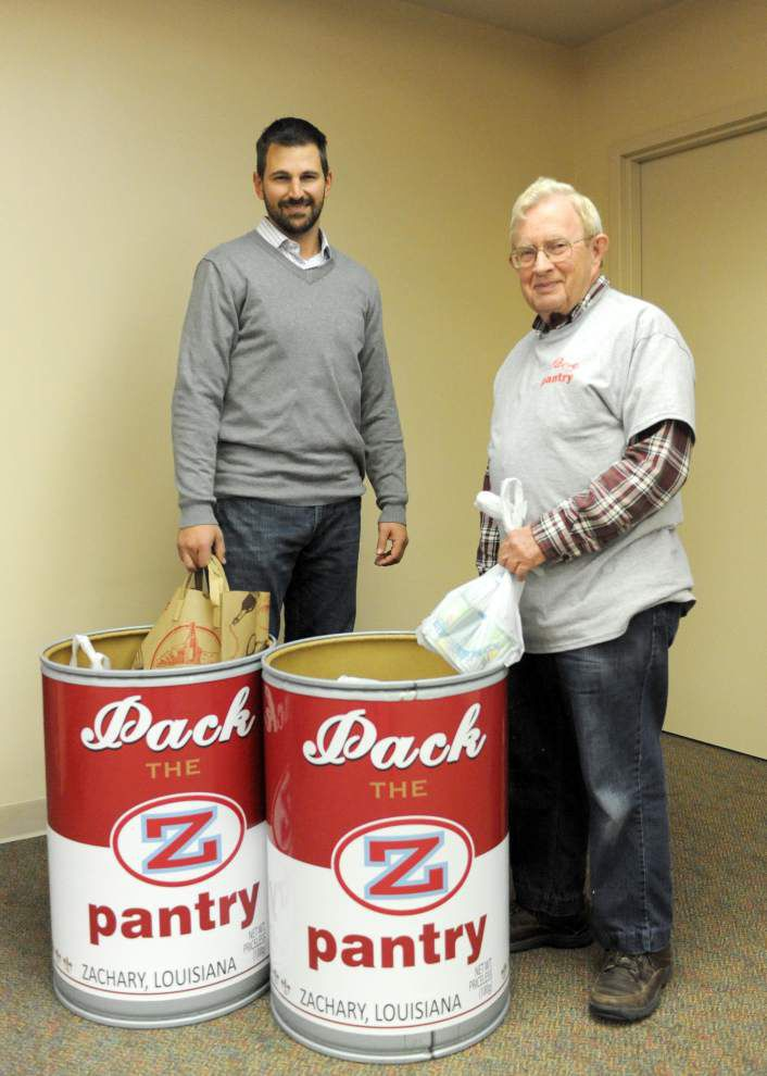 Rotary club 'passes the pig' for food pantry _lowres