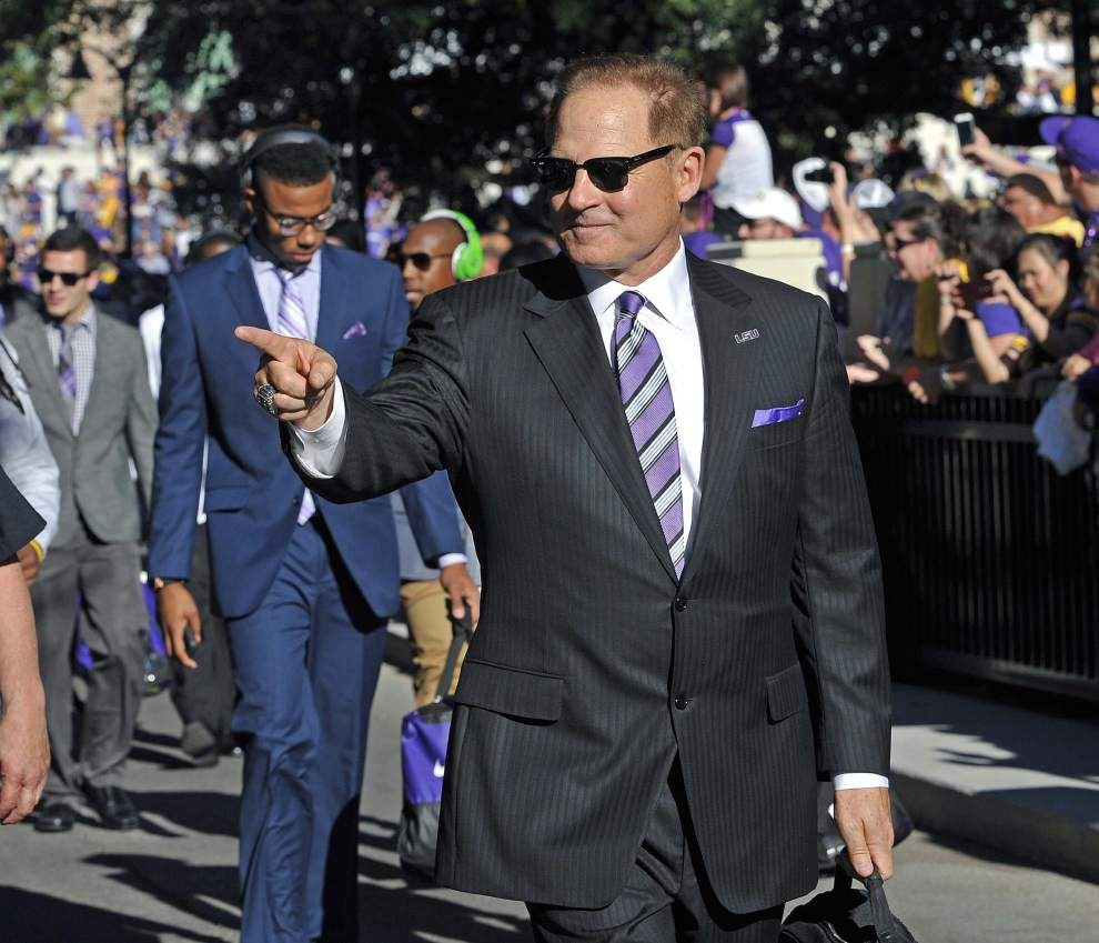 Sources: LSU coach Les Miles is focused on recruiting, assistants' contracts; staff has been told nothing of Michigan _lowres