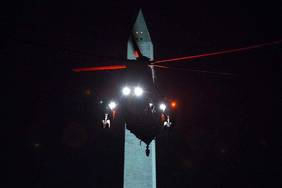 Obama back in Washington on rare vacation break _lowres