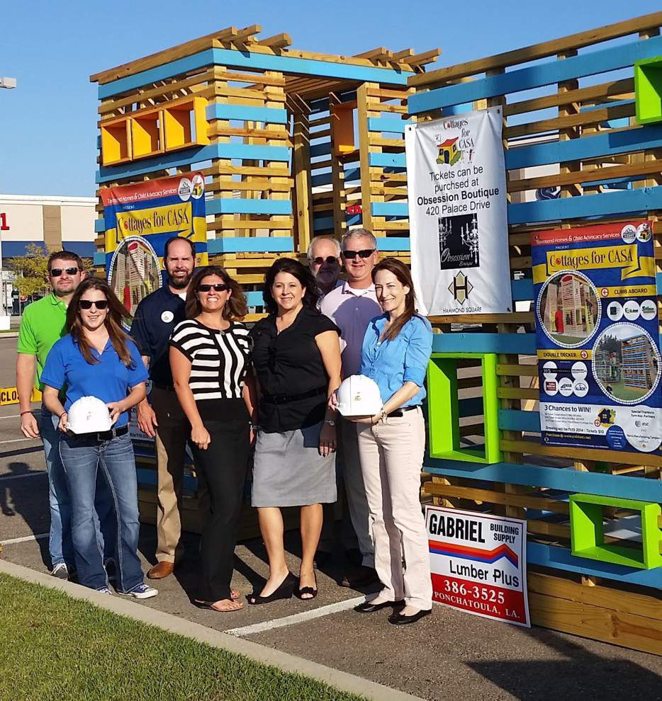 Cottages for CASA raises money for playhouses _lowres