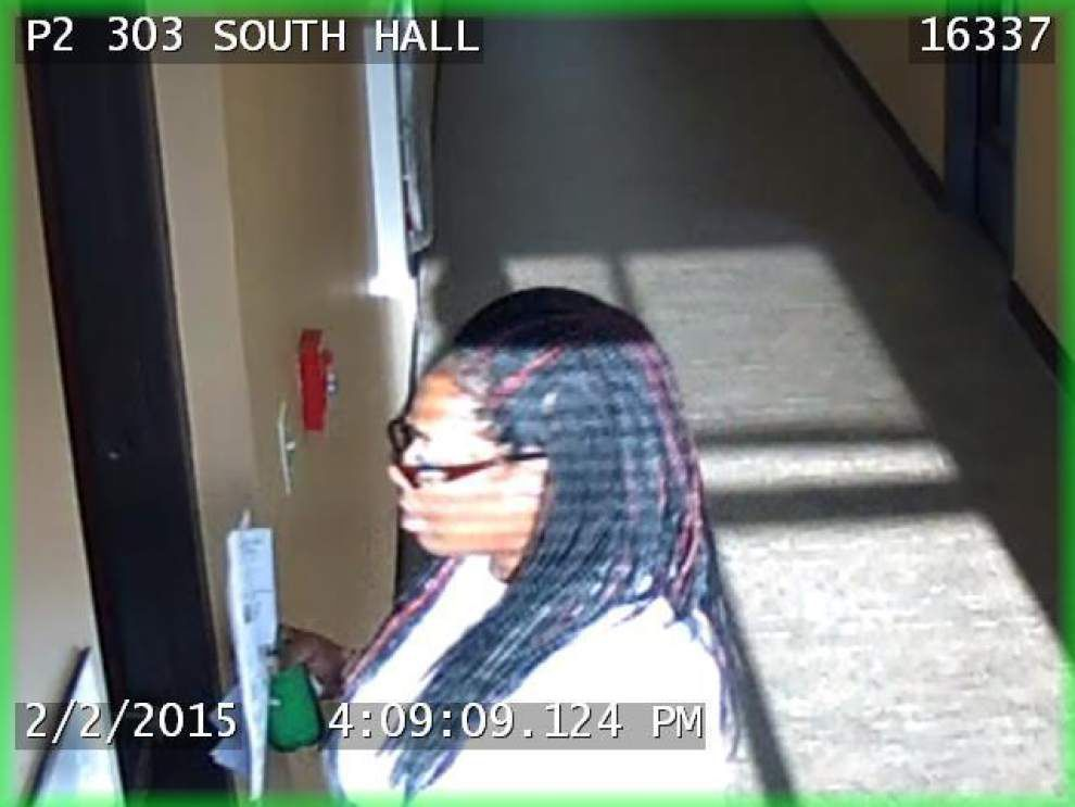 Police search for woman accused in thefts from two hospitals _lowres