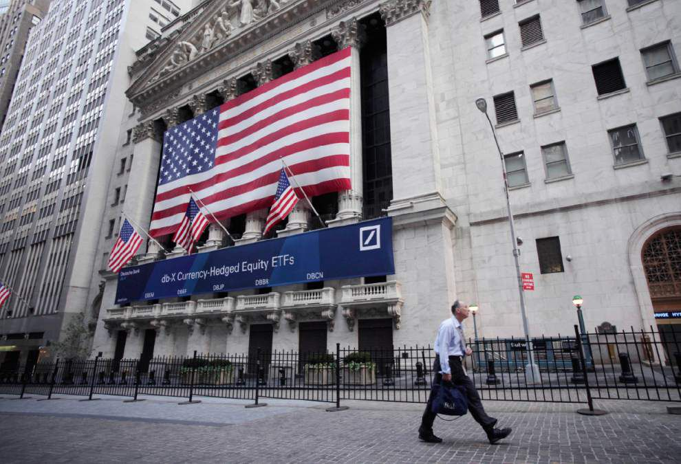 Shares mostly rise while dollar gains on euro, yen _lowres